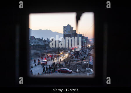 A view of the Baneshwor area of Kathmandu valley through a small window. - Stock Photo