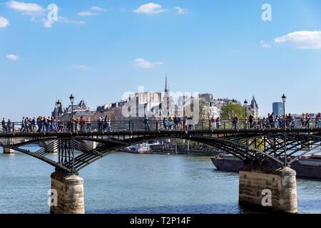 People walking on Pont des Arts bridge on the Seine river - Paris - Stock Photo