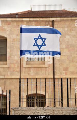 Israeli flag in Jerusalem - Stock Photo