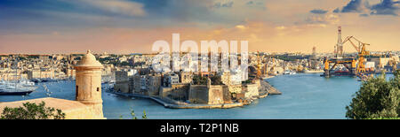 Panoramic view of Grand Harbour and port in Valletta at sunset. Malta - Stock Photo