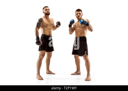 Respect for your opponent. Two professional fighters posing isolated on white studio background. Couple of fit muscular caucasian athletes or boxers f - Stock Photo