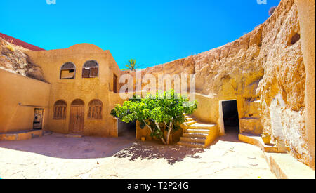 Courtyard of berber underground dwellings. Matmata, Tunisia, North Africa - Stock Photo