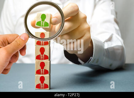 The leader chooses the person in the the team. Talented worker. Successful choice. Hiring staff. Employee search. Promote. Human Resource Management.  - Stock Photo