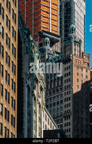 New York City - USA - Mar 11 2019: Close-up view of skyscrapers in Financial District Lower Manhattan New York City - Stock Photo