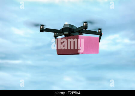 Drone carrying mail box for fast air delivery - Stock Photo