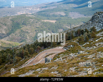 Very closed curve on a dangerous high mountain road from an aerial view on Pena de Francia, La Alberca (Salamanca) - Stock Photo