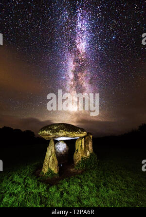 Spinsters rock on the Dartmoor national park is a neolithic dolmen (burial chamber) This shot was taken with a single 30 second exposure - Stock Photo