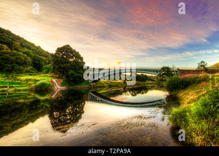 Showing Bigsweir iron bridge on the river wye which divides Wales from England and was built in 1827 - Stock Photo