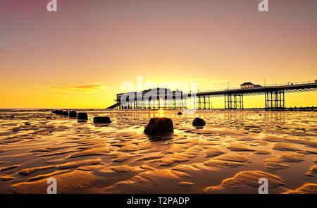 Cromer beach and Pier in Norfolk during a sunrise in the summer 2016 - Stock Photo