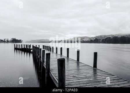 Black and white picture at a working jetty on Coniston water on the lake district in the UK - Stock Photo