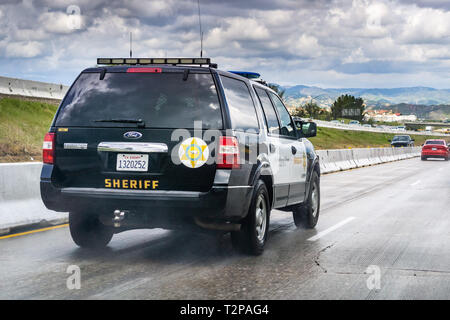 March 20, 2019 Los Angeles / CA / USA - Police car driving on the freeway - Stock Photo