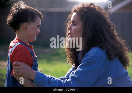 mother telling off her young son - Stock Photo