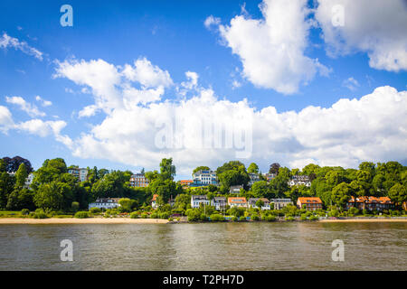 Hamburg, Germany - June 25, 2014: Summer view of the beach (Strand Oevelgoenne) on the Elbe river in Oevelgoenne district of Hamburg city. Popular pla - Stock Photo