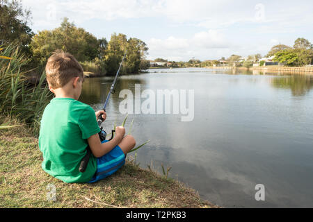 6 year old boy fishing at a local pond. Beachmere Queensland Australia. - Stock Photo
