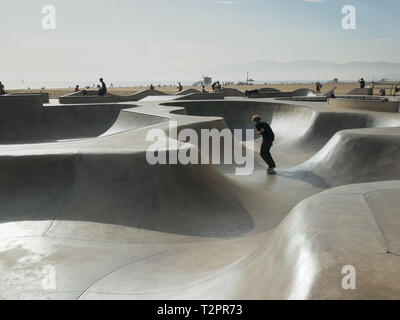 a skater rides the venice skate park in venice beach, los angeles, california - Stock Photo