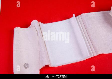 bandage open on red background - Stock Photo