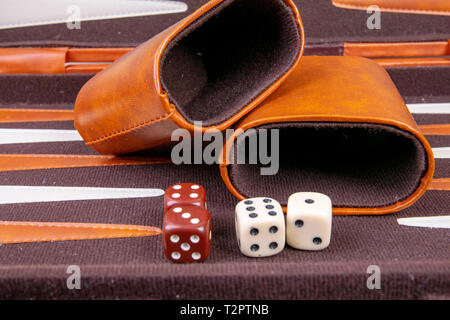 backgammon game with dice and dice cup - Stock Photo