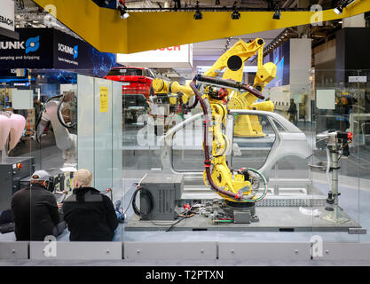Hanover, Lower Saxony, Germany - Hanover Fair, industrial robots at the Fanuc booth, here on the press highlight tour the day before the fair opening. - Stock Photo