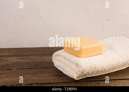 soap and towel on a wooden shelf in the bathroom. Interior of bathroom. - Stock Photo