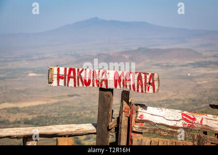 A handwritten sign that reads ' Hakuna Matata', Great rift valley overlook, Kenya - Stock Photo