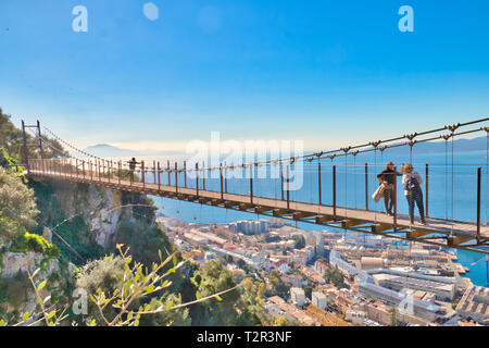 Gibraltar, Gibraltar - February 9, 2019: Tourists in Gibraltar crossing the Windsor suspension bridge, from where you can enjoy awesome views
