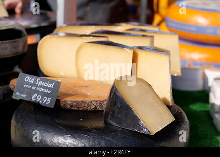 Close up of Dutch cheese on market stall - Stock Photo