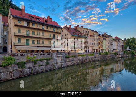 Cityscape view on Ljubljanica river canal in Ljubljana old town. Ljubljana is the capital of Slovenia and famous european tourist destination - Stock Photo