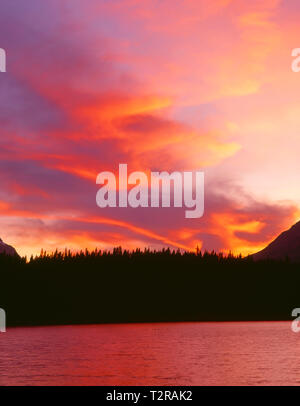 Canada, Alberta, Banff National Park, Flaming sunset over Mount Bosworth and Herbert Lake. - Stock Photo