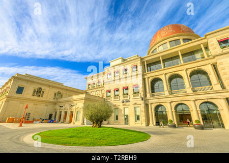 Doha, Qatar - February 17, 2019: facade of Katara Plaza at Katara Cultural Village, a new open-air shopping mall and upcoming commercial center in Wes - Stock Photo