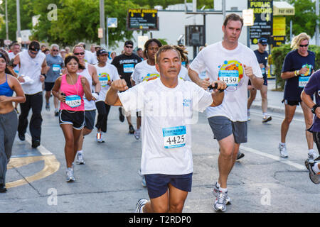 Miami Florida Bayfront Park Mercedes-Benz Miami Corporate Run community charity event runners coworkers co-workers man woman swe - Stock Photo