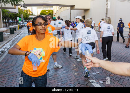 Miami Florida Bayfront Park Mercedes-Benz Miami Corporate Run community charity event runners walkers coworkers co-workers water - Stock Photo