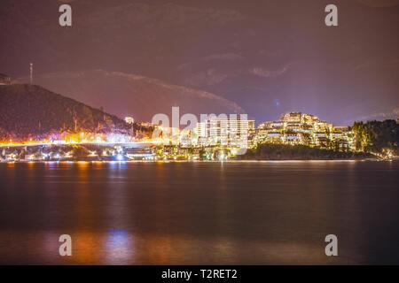 Night view to the bay, cityscape Budva, Montenegro. - Stock Photo