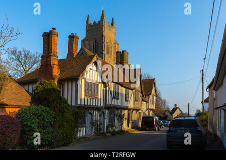 Stoke By Nayland, view of a row of medieval town houses in Church Street with the tower of St Mary The Virgin Church visible above them, Suffolk, UK - Stock Photo