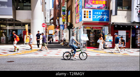 Pictured is a cyclist at Shibuya, Tokyo Japan. - Stock Photo