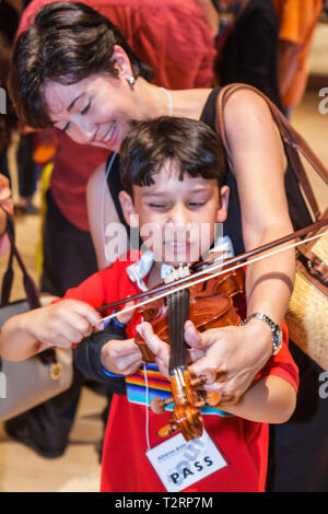 Miami Florida Adrienne Arsht Performing Arts Center centre Family Fest Instrument Discovery music hands on art education Hispani - Stock Photo