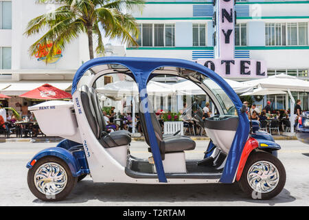 Miami Beach Florida South Beach Ocean Drive electric car self-guided tour rental rent computer guided talking car zero emissio - Stock Photo