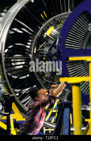 Skilled workman installing a part in a jet engine at the Pratt and Whitney factory in Connecticut, USA, - Stock Photo
