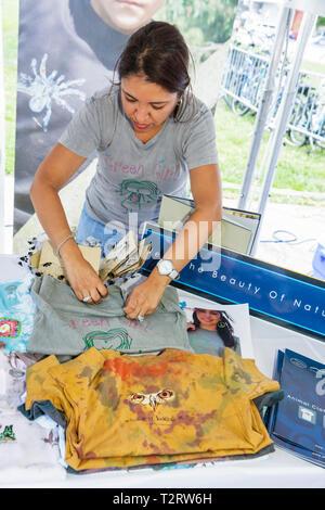 Miami Florida Bayfront Park Miami Goin' Green eco-friendly green event exhibitor entrepreneur woman natural fiber tee t-shirt cl - Stock Photo