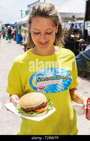 Miami Florida Bayfront Park Miami Goin' Green eco-friendly green event community fair woman food hamburger - Stock Photo