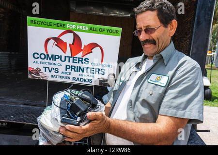 Miami Florida Bayfront Park Miami Goin' Green Earth Day celebration eco-friendly green event recycle tech recycling station Hisp - Stock Photo