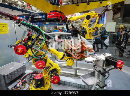Hanover, Lower Saxony, Germany - Hanover Fair, industrial robots at the Fanuc booth welding and transporting cars, here on the press highlight tour th - Stock Photo