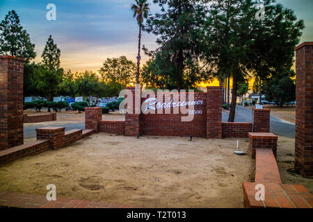 Lake Elsinore, California, USA - November 11, 2017: A welcoming signboard at the entry point of the resort - Stock Photo