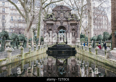 Paris, France - January 27, 2018: View of The Medici Fountain in the Luxembourg Gardens, Paris, France. The monumental fountain is a popular sightseei - Stock Photo