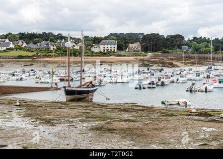 Perros-Guirec, France - July 30, 2018: Low tide at the beach of Saint-Guirec in Brittany - Stock Photo