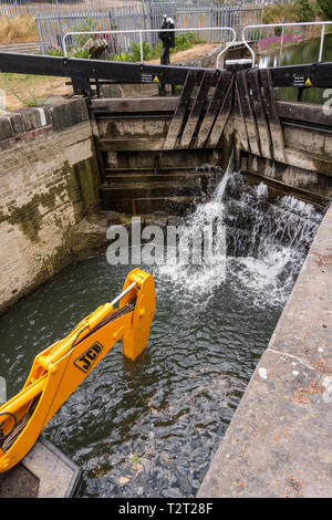 Specially adopted JCB digger in Stroudwater Navigation canal, Stroud, Gloucestershire, UK - Stock Photo