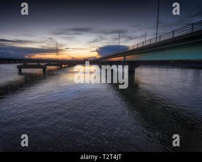 Road and rail bridges over the Loughor estuary - Stock Photo