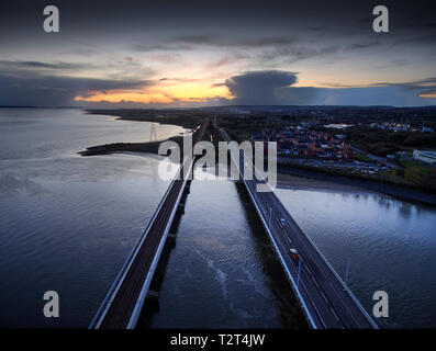 Loughor estuary road and rail bridges - Stock Photo