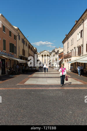 Bardolino attractive old town on the Veronese shore of Lake Garda. Its downtown is lined with shops, bars, restaurants and pizzerias. - Stock Photo