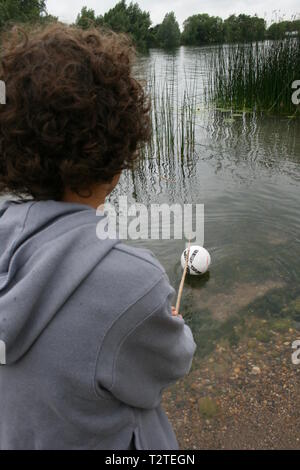 children playing near open water, risk to life - Stock Photo