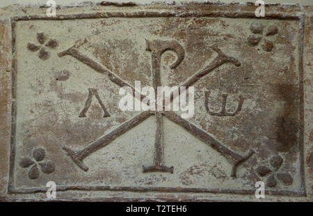The Chi-Rho symbol with Alpha and Omega. 4th-5th cent. Barcino (Barcelona). Archaeology Museum of Catalonia. Barcelona. Spain. - Stock Photo